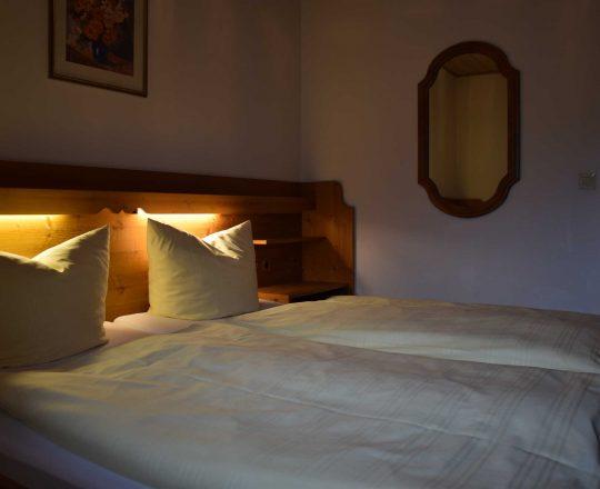 Hotel Ferienwohnungen Brunnthaler Bett